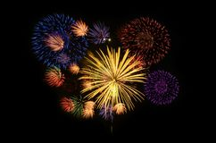 Fireworks celebration and the midnight sky background. royalty free stock image