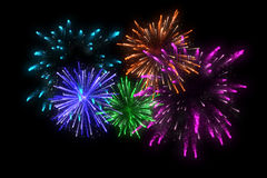 Colorful fireworks at celebration midnight. Royalty Free Stock Photos