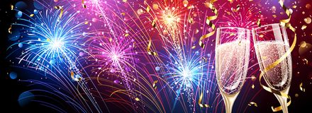 Colorful fireworks with champagne and confetti Royalty Free Stock Images