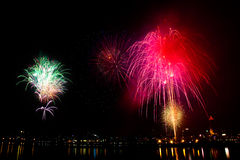 Colorful fireworks with city on the black sky Royalty Free Stock Image