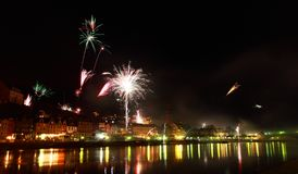 Colorful fireworks close to river Royalty Free Stock Images
