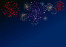 Colorful Fireworks on the dark-blue background. Fireworks on the dark-blue background Stock Image