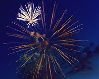 Colorful fireworks on dark night sky background. Holiday light. Colorful fireworks on dark night sky background. Holiday light Royalty Free Stock Image