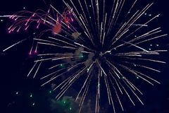 Colorful fireworks on dark night sky background. Holiday light. Colorful fireworks on dark night sky background. Holiday light Stock Photo