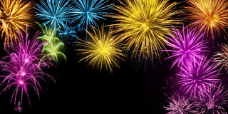 Colorful fireworks display on black Royalty Free Stock Images