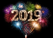 colorful fireworks display and bright sparkler pyrotechnic number 2019 happy new year background stock images