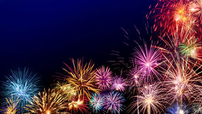 Colorful fireworks display on dark blue Royalty Free Stock Image