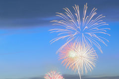 Colorful fireworks display on dusk sky background. In horizontal frame Stock Photography