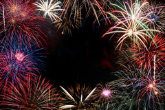 Colorful fireworks display forming a background Royalty Free Stock Images
