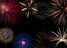 Colorful fireworks display forming a background Royalty Free Stock Image
