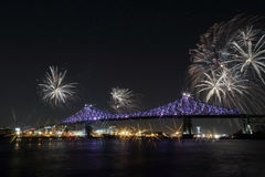 Colorful fireworks explode over bridge. Montreal's 375th anniversary. luminous colorful interactive Jacques C. Colorful fireworks explode over bridge Royalty Free Stock Photos