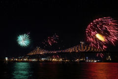 Colorful fireworks explode over bridge. Montreal's 375th anniversary. luminous colorful interactive Jacques C Stock Photos