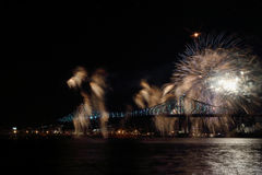Colorful fireworks explode over bridge. Montreal's 375th anniversary. luminous colorful interactive Jacques C Royalty Free Stock Photos