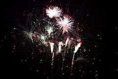 Colorful fireworks explode in sky. At new year royalty free stock photos