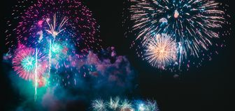 Colorful fireworks explosion on the black background stock photo