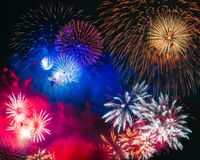 Colorful fireworks explosion on the black background royalty free stock photography