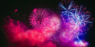 Colorful fireworks explosion on the black background royalty free stock photos