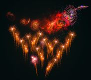 Colorful fireworks explosion on the black background. Colorful fireworks explosion on black background. New Year and Merry Christmas concept stock images