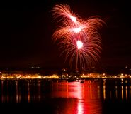 Colorful fireworks explosion with marvellous reflection on the sea, 4 of July, Independence day, explode, fireworks with village s royalty free stock photos
