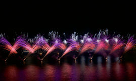 Colorful fireworks explosion, New Year, amazing fireworks isolated in dark background close up with the place for text, Malta fire Stock Photos
