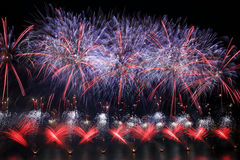 Colorful fireworks explosion, New Year, fireworks, orange amazing fireworks isolated in dark background close up with the place fo Stock Photos