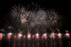 Colorful fireworks explosion, New Year, fireworks, orange amazing fireworks isolated in dark background close up with the place fo Stock Photo