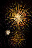Colorful Fireworks Explosions. Multiple bursts of fireworks paint the night sky with beautiful colors Stock Photos