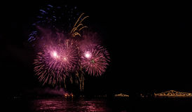 Colorful fireworks glowing outlines of military ships, Stock Image