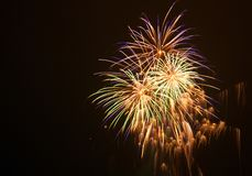 Colorful fireworks at holiday night. Blurred Image of salutes stock image