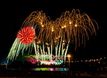 Colorful fireworks with multiple bursts  against dark sky. Colorful fireworks with multiple bursts against dark sky Royalty Free Stock Photos