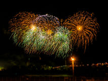 Colorful fireworks with multiple bursts  against dark sky. Colorful fireworks with multiple bursts against dark sky Stock Photo