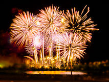Colorful fireworks with multiple bursts against dark sky Stock Photo