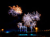Colorful fireworks with multiple bursts   against dark sky. Colorful fireworks with multiple bursts against dark sky Royalty Free Stock Photography