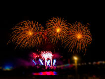 Colorful fireworks with multiple bursts  against dark sky. Colorful fireworks with multiple bursts against dark sky Stock Photos
