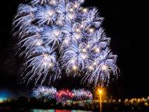 Colorful fireworks  with multiple bursts against dark sky. Colorful fireworks with multiple bursts against dark sky Stock Images