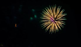 Colorful fireworks near water royalty free stock images