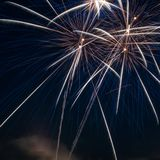 Colorful fireworks over dark sky Royalty Free Stock Images