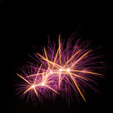 Colorful fireworks over dark sky background Stock Images