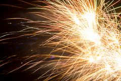 Colorful fireworks over dark sky. Colorful bright fireworks over dark night sky Royalty Free Stock Image