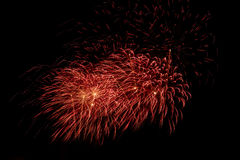 Colorful fireworks over dark sky, displayed during a celebration event. New Year colorful celebration fireworks Stock Images