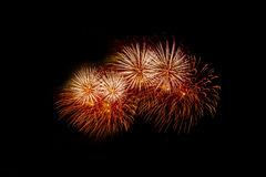 Colorful fireworks over dark sky, displayed during a celebration event. New Year colorful celebration fireworks Stock Photos