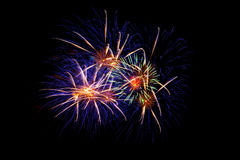 Colorful fireworks over dark sky, displayed during a celebration event. New Year colorful celebration fireworks Stock Photography