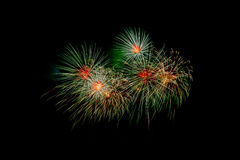 Colorful fireworks over dark sky, displayed during a celebration event. New Year colorful celebration fireworks Royalty Free Stock Photo