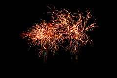 Colorful fireworks over dark sky, displayed during a celebration event. New Year colorful celebration fireworks Royalty Free Stock Photography