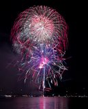 Colorful fireworks over the lake Stock Images