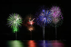 Colorful Fireworks over Lake Royalty Free Stock Photography
