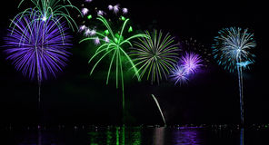 Colorful Fireworks over Lake Stock Photo