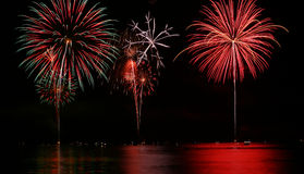 Colorful Fireworks over Lake Stock Photos