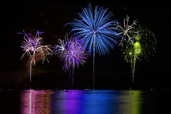 Colorful Fireworks over Lake Royalty Free Stock Images