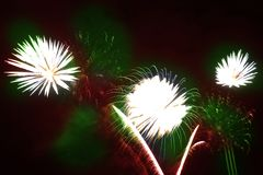 Colorful fireworks over a night sky Royalty Free Stock Images